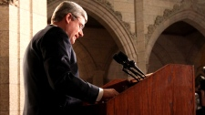 Prime Minister Stephen Harper gives a news conference regarding the developing situation in Libya, on Parliament Hill in Ottawa, Friday, Feb. 25, 2011. (Fred Chartrand / THE CANADIAN PRESS)