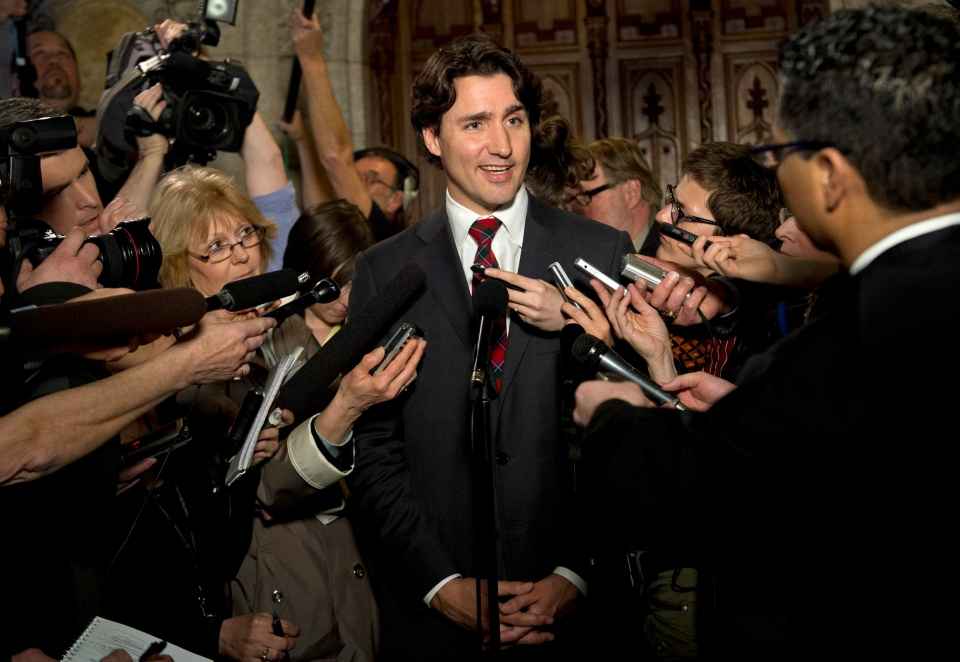 Liberal Leader Justin Trudeau speaks to reporters following Question Period in the Foyer of the House of Commons on Parliament Hill Monday, April 15, 2013. (Justin Tang / THE CANADIAN PRESS)