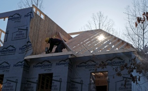Housing starts in the United States have hit a five-year high. In this Friday, March 29, 2013, photo, a worker helps frame a new home under construction in Matthews, N.C.  (AP / Chuck Burton)