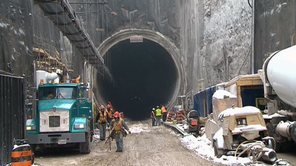 Crews work in a hydro tunnel being built under the City of Niagara Falls. The project is $615 million over budget and four years behind.