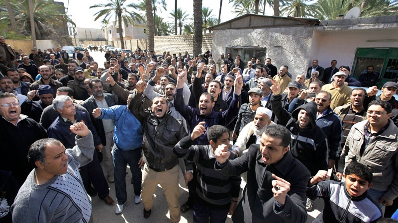 Mourners shout anti-regime chants at the funeral of Anwar Algadi, 44, in the Tajoura district of eastern Tripoli, Libya, Saturday, Feb. 26, 2011. (AP / Ben Curtis)