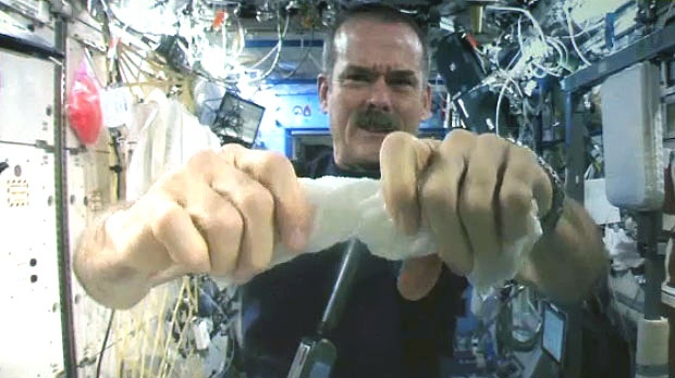 Chris Hadfield performs Lockview High School's winning experiment aboard the International Space Station on April 16, 2013. (CTV Atlantic)