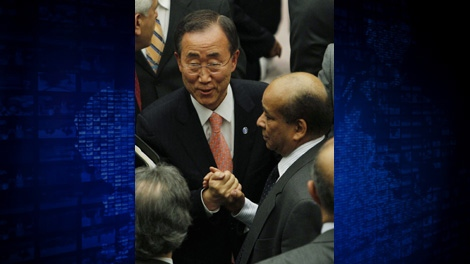 United Nations Secretary-General Ban Ki-moon greets Libya's UN ambassador Mohamed Shalgham after a meeting of the Security Council at UN headquarters in New York Friday, Feb. 25, 2011. (AP Photo/Frank Franklin II)