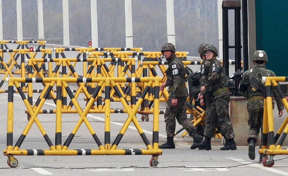 South Korean Army soldiers patrol on Unification Bridge in Paju, South Korea, near the border village of Panmunjom, Tuesday, April 16, 2013. (AP / Ahn Young-joon)