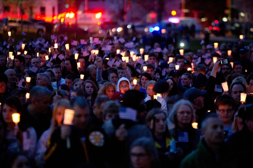 Mourners attend candlelight vigil for Martin Richard at Garvey Park, near Richard's home in the Dorchester section of Boston, on Tuesday, April 16, 2013. (The New York Times / Josh Haner)