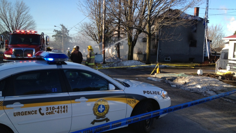 Firefighters respond to the house fire in Thurso, Que. early Wednesday, April 17, 2013. (Jim O'Grady / CTV Ottawa)