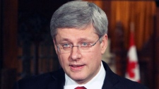 Prime Minister Stephen Harper gives a news conference regarding the developping situation in Libya, on Parliament Hill in Ottawa, Friday, Feb. 25, 2011. (Fred Chartrand / THE CANADIAN PRESS)