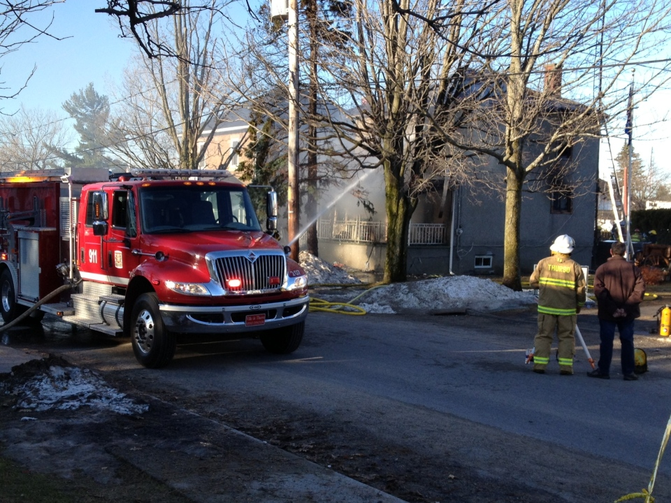 Firefighters at the scene of a house fire in Thurso, Quebec on Wednesday April 17, 2013.