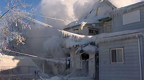 Ice covers a home in the West End as crews continue to fight the fire inside.