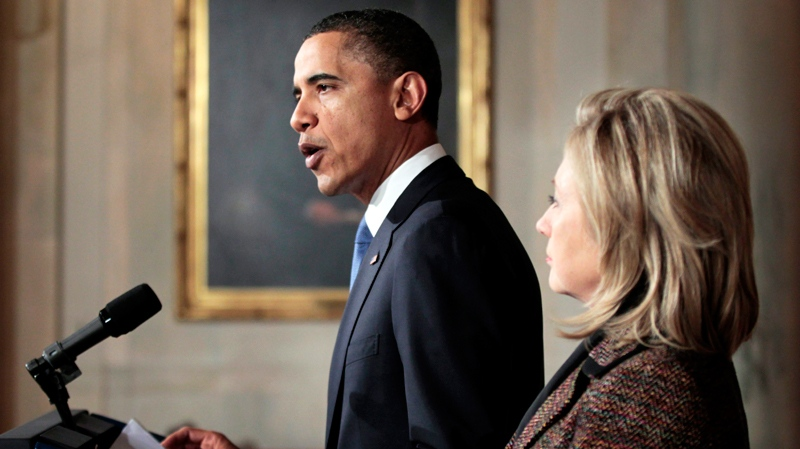 President Barack Obama, left, with Secretary of State Hillary Rodham Clinton, right, delivers a statement on Libya in the Grand Foyer of the White House in Washington, Wednesday, Feb. 23, 2011. (AP / Pablo Martinez Monsivais)