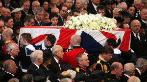 The coffin containing the body of former British Prime Minister Margaret Thatcher leaves the ceremonial funeral at St Paul's Cathedral in London, Wednesday April 17, 2013. (AP / Christopher Furlong)