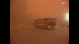 Sand storm shrouds northwest China