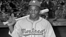 Montreal Royals Jackie Robinson poses in this April 18,1946 photo. This is where Jackie Robinson began his climb to the big leagues and history, where Pete Rose stroked his 4,000th hit, where the major leagues first put down roots outside the United States. Now the rich baseball history of Montreal may become only that _ history. (AP Photo/John J. Lent)