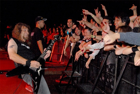 Anvil co-founder and lead guitarist Lips strums for concertgoers in a scene from 'Anvil! The Story of Anvil.'