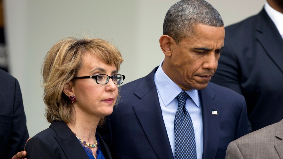 President Barack Obama, right, puts his arm around former Rep. Gabrielle Giffords, D-Ariz., before he speaks in the Rose Garden at the White House in Washington, Wednesday, April 17, 2013. (AP / Manuel Balce Ceneta)
