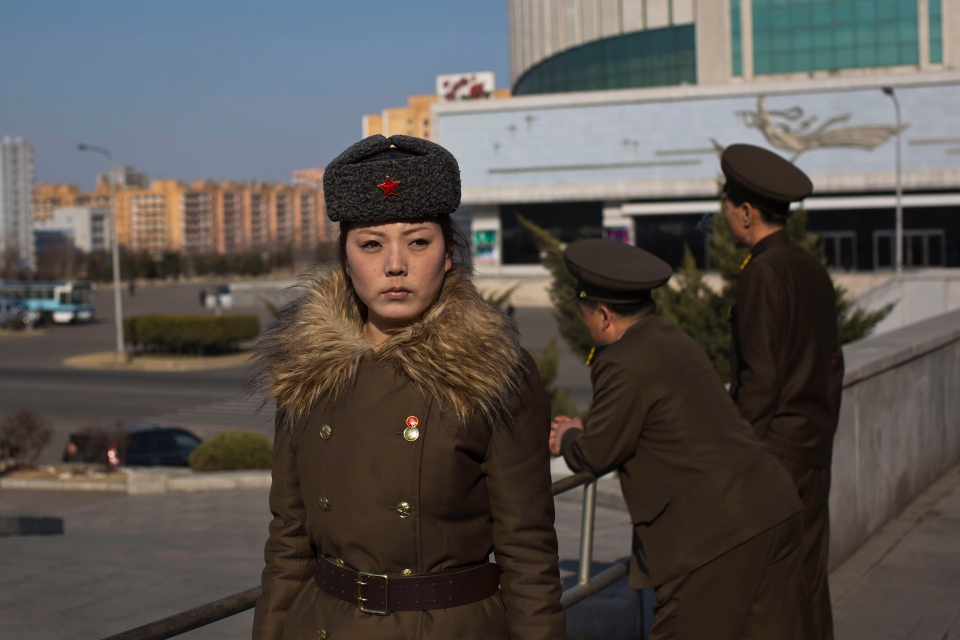 FILE - In this Friday, April 12, 2013 file photo, North Korean soldiers stand together along a street in Pyongyang, North Korea. (AP Photo/David Guttenfelder, File)