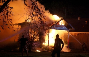 Homes and buildings are in ruins following a massive explosion at fertilizer plant in Texas that left a number of people dead and injured. <br><br>A person looks on as emergency workers fight a house fire after a near by fertilizer plant exploded Wednesday, April 17, 2013, in West, Texas. (Waco Tribune Herald, Rod Aydelotte)
