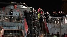 Passengers disembark from Britain Royal Navy HMS Cumberland at the harbor in Valletta, Malta, Saturday, Feb. 26, 2011. (AP / Gregorio Borgia)