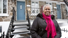 Sharon Robinson stand in front of the house inhabited by her father, Hall of Fame baseball legend and civil rights leader Jackie Robinson while he lived in Montreal in 1946, during the unveiling of a commemorative plaque Monday, February 28, 2011 in Montreal. THE CANADIAN PRESS/Paul Chiasson