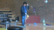 Student cleans up after gory performance