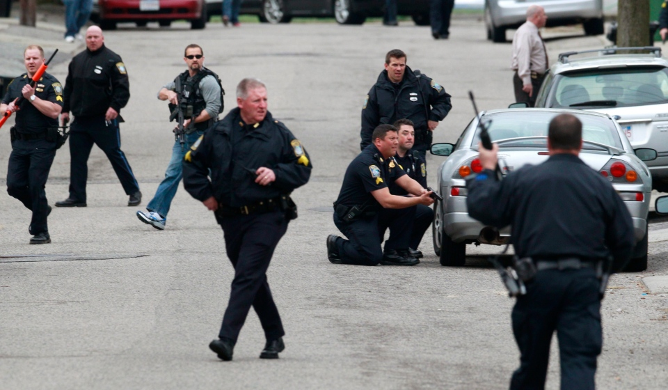 Police surround a home while searching for a suspect in the Boston Marathon bombings in Watertown, Mass., Friday, April 19, 2013.  (AP /Charles Krupa)