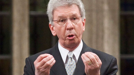 Minister of Veterans Affairs Jean-Pierre Blackburn gestures as he speaks during Question Period on Parliament Hill in Ottawa on Friday, Feb. 4, 2011. (Pawel Dwulit / THE CANADIAN PRESS)