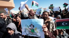 Libyan anti-government protesters, some carrying monarchist-era flags, demonstrate against Libyan leader Moammar Gadhafi, in the southwestern town of Nalut, Libya, Tuesday, March 1, 2011.  (AP / Lefteris Pitarakis)
