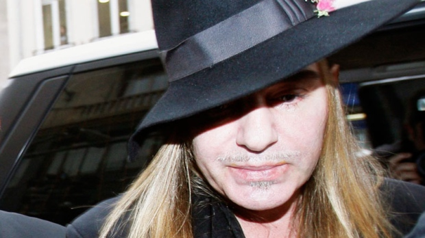 Fashion designer John Galliano arrives at a police station in Paris on Monday, Feb. 28, 2011. Christian Dior has fired Galliano in wake of alleged anti-Semitic remarks he made during a dispute at a trendy Paris cafe. (AP / Michel Euler)