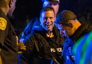 Boston police celebrate bombing suspect arrest