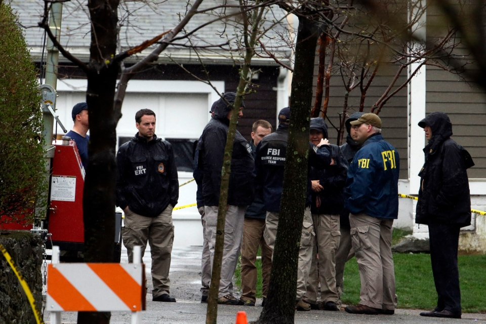 Investigators work near the location on Saturday, April 20, 2013 where on Friday night a suspect in the Boston Marathon bombings was arrested in Watertown, Mass. (AP / Matt Rourke)
