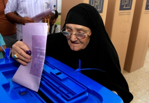 An elderly Iraqi woman casts her ballot at a polling center during the country's provincial elections in Baghdad, Iraq, Saturday, April 20, 2013. (AP / Karim Kadim)