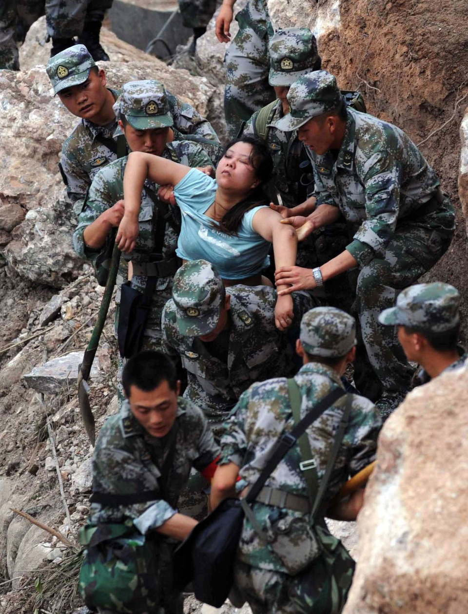 Rescuers save an injured woman after an earthquake hit Baosheng Township in Lushan County, Ya'an City, southwest China's Sichuan Province, Saturday, April 20, 2013. (Xinhua, Jiang Hongjing)