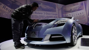 Global and Chinese automakers showcase family-friendly sedans and SUVs targeting coveted urban buyers at China&#39;s biggest auto show Saturday as competition intensifies in this huge but crowded market. <br><br>Workers clean a Buick Riviera Concept 2013 model displayed ahead of the Shanghai International Automobile Industry Exhibition (AUTO Shanghai) in Shanghai, China, Friday, April 19, 2013. (AP / Eugene Hoshiko)