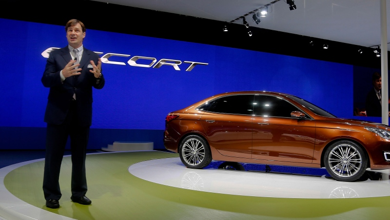 Ford Motor's Jim Farley, speaks to the media after unveiling the new Ford Escort model at the Shanghai International Automobile Industry Exhibition (AUTO Shanghai) media day in Shanghai, Saturday, April 20, 2013. (AP)