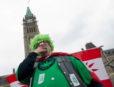 A man smokes a joint in front of Parliament Hill