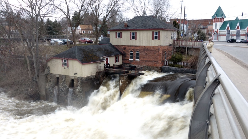 Water rushes over a dam in Bracebridge, Ont., Saturday, April 20, 2013. (Tom Podolec / CTV Toronto)