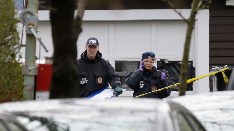 Investigators work near the location where the previous night a suspect in the Boston Marathon bombings was arrested in Watertown, Mass. on Saturday, April 20, 2013. (AP / Matt Rourke)