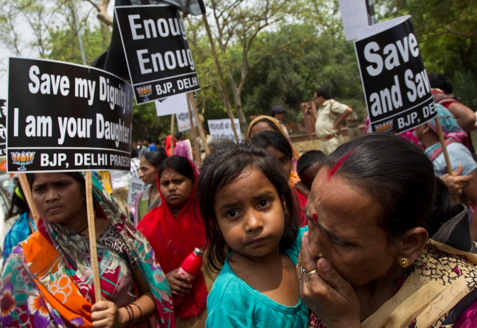 Women activists of India's main opposition Bharatiya Janata Party hold placards near the residence of ruling Congress party president Sonia Gandhi during a protest against the rape of a 5-year-old girl in New Delhi, India, Sunday, April 21, 2013. (AP / Tsering Topgyal)
