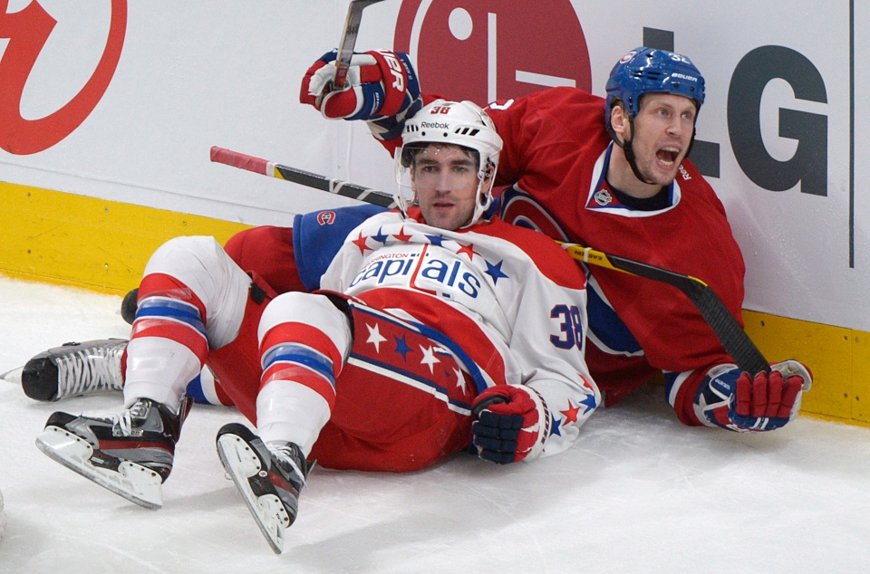 Montreal Canadiens' Travis Moen, right, collides with Washington Capitals' Jack Hillen during second period NHL hockey action in Montreal, Saturday, April 20, 2013. THE CANADIAN PRESS/Graham Hughes.