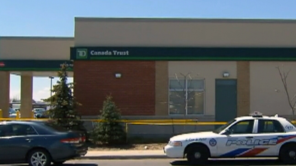 Two people have been shot and wounded at a TD bank on St. Clair Avenue in Toronto, Sunday, April 21, 2013.