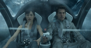 Olga Kurylenko, left, and Tom Cruise are seen in a scene from 'Oblivion' in this image released by Universal Pictures.