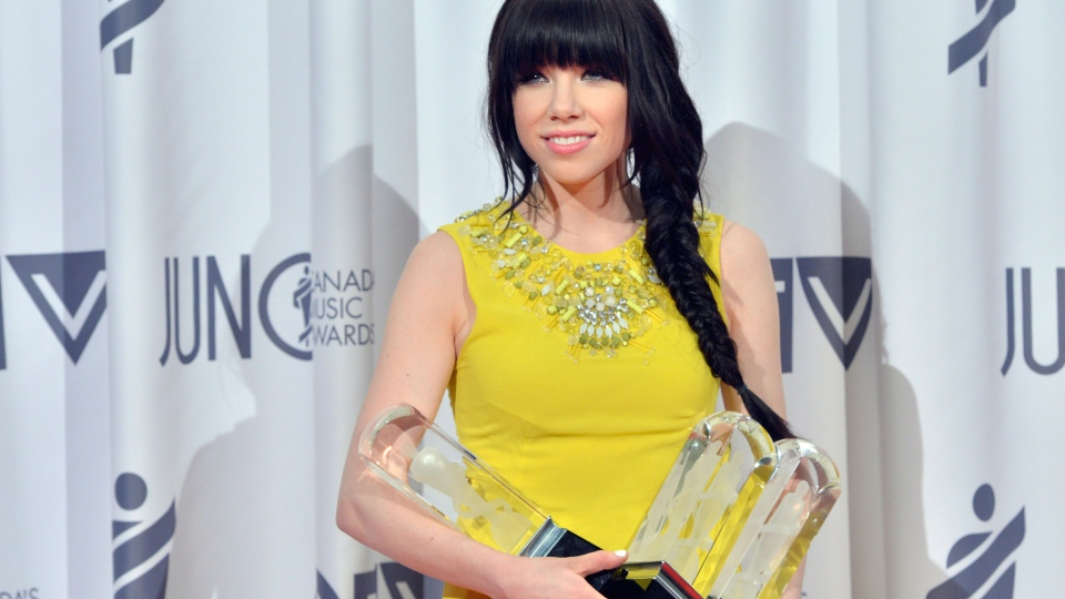 Carly Rae Jepsen poses with the Juno after winning pop album of the year, album of the year, and single of the year of the Year during the 2013 Juno Gala, Dinner and Awards in Regina on Sunday, April 21, 2013. (Liam Richards / THE CANADIAN PRESS)