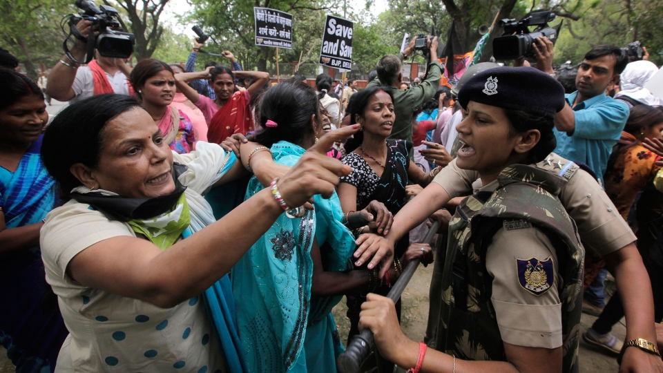 Women activists of India's main opposition Bharatiya Janata Party are stopped by police near the residence of ruling Congress party president Sonia Gandhi during a protest against the rape of a 5-year-old girl in New Delhi, India, Sunday, April 21, 2013. (AP / Manish Swarup)