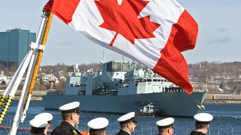 Sailors look on as HMCS Charlottetown heads from berth in Halifax on Wednesday, March 2, 2011. (Andrew Vaughan / THE CANADIAN PRESS)