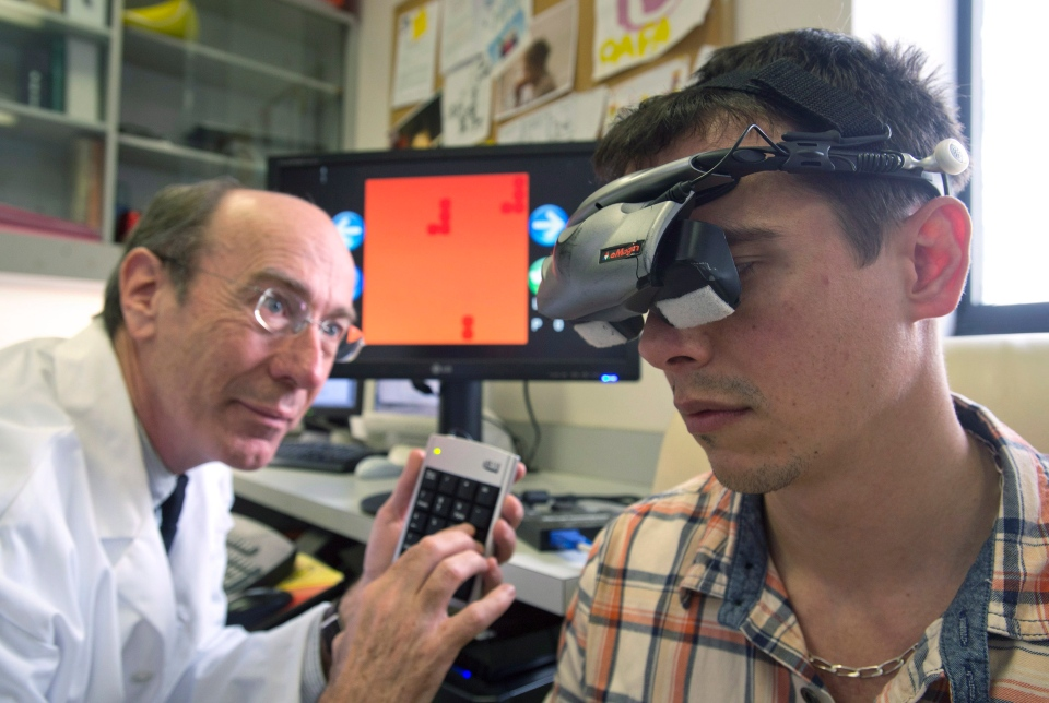 McGill University research director Professor Robert Hess, left, and Dr. Simon Clavagnier, a McGill vision research associate, demonstrate the effect of wearing goggles while playing the game Tetris has on a lazy eye in Montreal, Monday, April 22, 2013. (Graham Hughes / THE CANADIAN PRESS)