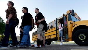 High school students from West, Texas, arrive for classes at a temporary facility provided by the Connally Independent School District, in Waco, Texas, Monday, April 22, 2013. (AP / Charlie Riedel)