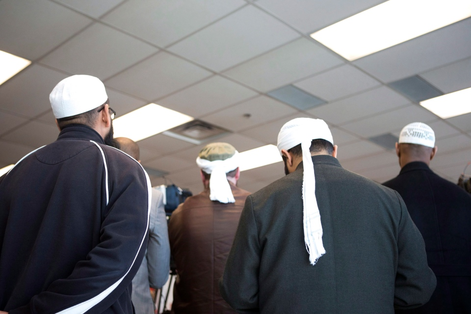 Representatives of Toronto's Islamic community attend a press conference as the RCMP announce the arrest of two men accused of plotting a terror attack on rail target, in Toronto, Monday, April 22, 2013. (Chris Young / THE CANADIAN PRESS)