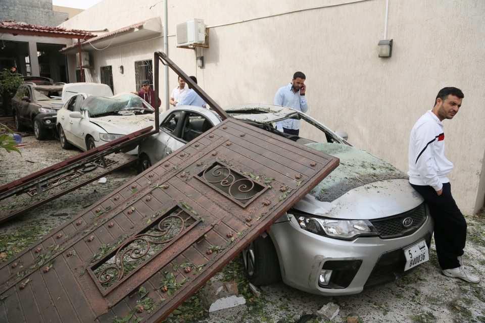 Damaged cars are seen at the site of a car bomb that targeted the French embassy wounding two French guards and causing extensive material damage in Tripoli, Libya, Tuesday, April 23, 2013. (AP / Abdul Majeed Forjani)
