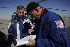 Steve Lindsey, Chief of NASA's Astronaut office, left, and Michael Sufferdini, International Station Program Manager, examine a map of central Kazakhstan as they received information at the Arkalyk airport on Saturday, April 19, 2008 on the landing of the Expedition 16 crew in the Soyuz TMA-11 capsule. (AP Photo/NASA/Bill Ingalls)