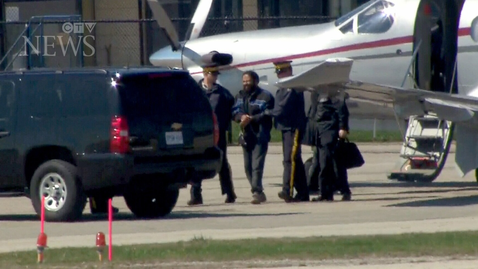 Terror suspect Chiheb Esseghaier is led off a plane by RCMP officers in Markham, Ont., on Monday, April 22, 2013. (Ted Brooks / CTV News)